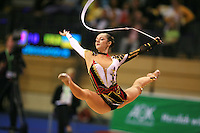 Anna Bessonova of Ukraine split leaps with ribbon at Berlin Grand Prix Finale at Berlin, Germany on Octoberl 22, 2006.<br />