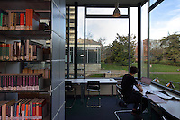 Students studying in the library, which stocks 20,000 books, 90% of which are German language publications, in the Maison de L'Allemagne or Germany House, or Maison Heinrich Heine, designed by Johannes Krahn, 1908-1974, and opened in 1956, in the Cite Internationale Universitaire de Paris, in the 14th arrondissement of Paris, France. The CIUP or Cite U was founded in 1925 after the First World War by Andre Honnorat and Emile Deutsch de la Meurthe to create a place of cooperation and peace amongst students and researchers from around the world. It consists of 5,800 rooms in 40 residences, accepting another 12,000 student residents each year. Picture by Manuel Cohen. Further clearances may be requested.