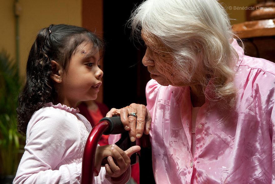 Reynita, a resident of Casa Xochiquetzal, talks with a little girl visiting the shelter in Mexico City, Mexico on March 4, 2008. Casa Xochiquetzal is a shelter for elderly sex workers in Mexico City. It gives the women refuge, food, health services, a space to learn about their human rights and courses to help them rediscover their self-confidence and deal with traumatic aspects of their lives. Casa Xochiquetzal provides a space to age with dignity for a group of vulnerable women who are often invisible to society at large. It is the only such shelter existing in Latin America. Photo by Bénédicte Desrus