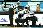 24 November 2012: Referees Billy Smith (center), Joseph Vaszily, and Dawn Marsh review a controversial play on a monitor during the second half. The University of North Carolina Tar Heels played the La Salle University Explorers at Carmichael Arena in Chapel Hill, North Carolina in an NCAA Division I Women's Basketball game. UNC won the game 85-55.