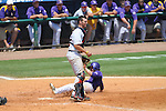 LSU's Tyler Hanover  scores behind Ole Miss' Will Allen at Regions Park in the SEC Tournament in Hoover, Ala. on Thursday, May 24, 2012.  .LSU won 11-2.