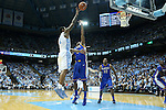 22 December 2012: North Carolina's Leslie McDonald (left) shoots over McNeese State's Jeremie Mitchell (center). The University of North Carolina Tar Heels played the McNeese State University Cowboys at the Dean E. Smith Center in Chapel Hill, North Carolina in an NCAA Division I Men's college basketball game. UNC won the game 97-63.