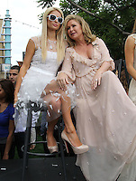 "Paris Hilton, Kathy Hilton.Gabriel Mann And Kathy And Paris Hilton Fashion Show On ""Extra"" Held at The Grove, West Hollywood, California, USA..May 2nd, 2012.full length white sheer beige pink sunglasses shades mother mom mum daughter family dress.CAP/ADM/KB.©Kevan Brooks/AdMedia/Capital Pictures."