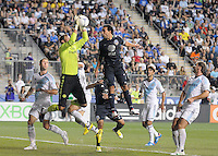 Chelsea FC goal keeper Ross Turnbull (22) goes up to make a save against MLS All Stars midfielder Dwayne De Rosario (7) The MLS All Stars Team defeated Chelsea FC 3-2 at PPL Park Stadium, Wednesday 25, 2012.