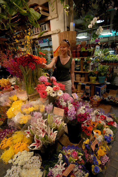 Reading Terminal Market, woman buying flowers, mod rel..Philadelphia, Pennsylvania, PA USA.  Photo copyright Lee Foster, 510-549-2202, lee@fostertravel.com, www.fostertravel.com.  Photo 226-30517