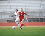 Oxford High's sarah Nash (19) vs. Lafayette High's Abbey Pate (6) in girls high school soccer in Oxford, Miss. on Saturday, December 8, 2012. Oxford won 1-0.