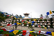 Prayer flags flutter on top of the Dochu La (mountain pass) in the outskirts (30 kms) of Thimphu, Bhutan. Dochu La has become a major tourist attraction because of its 108 stupas on the pass. Photo: Sanjit Das/Panos