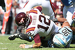 04 October 2014: Virginia Tech's Michael Brewer (12) is sacked by UNC's Nazair Jones (90). The University of North Carolina Tar Heels hosted the Virginia Tech Hokies at Kenan Memorial Stadium in Chapel Hill, North Carolina in a 2014 NCAA Division I College Football game. Virginia Tech won the game 34-17.