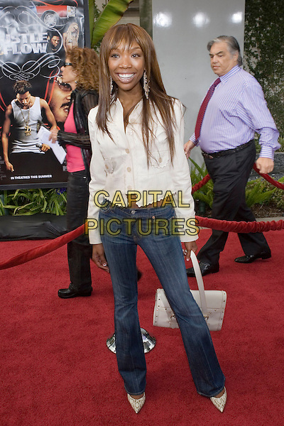 """BRANDY.At the """"Hustle & Flow"""" Los Angeles Film Premiere,.held at the Arclight Cinerama Dome, .Hollywood, California, USA, 20th July 2005..full length cream jacket skinny jeans.Ref: ADM.www.capitalpictures.com.sales@capitalpictures.com.©Zach Lipp/AdMedia/Capital Pictures."""