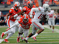 Ohio State Buckeyes wide receiver Philly Brown (10) carries the ball while almost tackled by Illinois Fighting Illini linebacker T.J. Neal (52) in the quarter of their game at Memorial Stadium in Champaign, Ill on November 16, 2013. (Columbus Dispatch photo by Brooke LaValley)