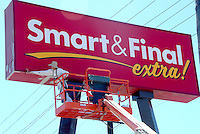 "Humberto Sosa, from Rossi Painting, paints the new Smart & Final Extra! sign Lincoln Blvd. on Tuesday, July 19, 2011.  Smart & Final Extra!, one of the company's newest store concepts, is designed to enhance the household consumer's shopping experience and also includes changes to benefit  business customers. The Smart & Final Extra! store offers extra features.  The newly remodeled store will carry a greatly expanded selection of  ""every day"" products in key categories like produce, fresh meat, frozen foods, dairy, deli and grocery basics like cereal, yogurt, bread and snacks.  The store also include entirely new sections  for baby food and diapers and health and beauty care."