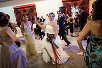 26 year old Nasim dances at her wedding reception. By law women and men should stay separate at weddings but many people, in private, ignore this restriction and celebrate their wedding in mixed company.