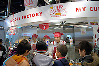 Children crowd round a make your own cup noodle corner. The museum is often busy with school groups from the surrounding area. The Instant Ramen Museum in Ikeda, near the Japanese city of Osaka, has welcomed some 2 million visitors over the years.