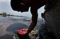 Jason Melerine blue crab fishing in Delacroix Island, Louisiana on May 25th, 2010.
