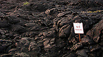 Hardened lava has wiped out many acres of land including some of the road about Hawai'i Volcanoes National Park on the Big Island of Hawaii, occasionally with humorous consequences.