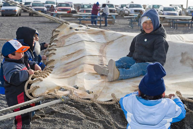 Native Alaskan Inupiaq children play during the Nalukataq festival, held to celebrate the successful subsistence whale hunt in Utqiagvik (Barrow), Alaska.