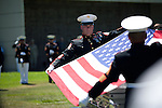 Fellow marines fold a U.S. flag during the memorial  of First Lt. Todd Allen Lorell, 24, of Los Altos.<br />