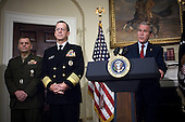 United States President George W. Bush (right) announces the nomination of Admiral Mike Mullen (2nd from left), U.S. Navy, and General James E. Cartwright as Chairman and Vice-Chairman of the Joint Chiefs of Staff, respectively, in the Roosevelt Room at the White House on June 28, 2007.  Mullen is currently the Chief of Naval Operations and Cartwright is the Commander of the U.S. Strategic Command. Cartwright is a target of a Justice Department investigation into a leak of information about a covert U.S.-Israeli cyberattack on Iran&rsquo;s nuclear program.<br /> Mandatory Credit: Chad J. McNeeley / DoD via CNP