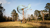 Author Chris Vitiello stand among whirligigs created by Vollis Simpson, a renowned outsider artist, Lucama, N.C., Jan. 26, 2013.