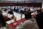 Palestinians attend a meeting of chamber of commerce and industry, in Gaza city on Sep. 30, 2014. Photo by Mohammed Asad