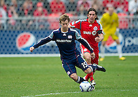 22 May 2010: New England Revolution forward Zack Schilawski #15 takes the ball as Toronto FC defender Nick Garcia #4 gives chase during a game between the New England Revolution and Toronto FC at BMO Field in Toronto..Toronto FC won 1-0.....