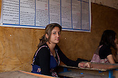 DOMIZ, IRAQ: Shireen, a student at a makeshift school, in the Domiz refugee camp...Over 7,000 Syrian Kurds have fled the violence in Syria and are living in the Domiz refugee camp in the semi-autonomous region of Iraqi Kurdistan...Photo by Ali Arkady/Metrography