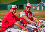 22 May 2015: Washington Nationals infielder Yunel Escobar (right) takes stretching exercises prior to a game against the Philadelphia Phillies at Nationals Park in Washington, DC. The Nationals defeated the Phillies 2-1 in the first game of their 3-game weekend series. Mandatory Credit: Ed Wolfstein Photo *** RAW (NEF) Image File Available ***