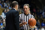 08 November 2014: Referee Mike Eades (right) talks with Central Missouri head coach Doug Karleskint (left). The Duke University Blue Devils hosted the University of Central Missouri Mules at Cameron Indoor Stadium in Durham, North Carolina in an NCAA Men's Basketball exhibition game. Duke won the game 87-47.