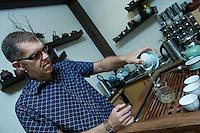 Quebec city, August 1, 2008 - Philip Brook prepares three cups of tea at the Camellia Sinensis tea house on St-Joseph street in Quebec city.