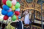 Sergei and Irine Kopylov ride a carousel in Gorky Park to celebrate their wedding on Saturday, August 17, 2013 in Moscow, Russia.