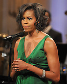 "Washington, D.C. - February 25, 2009 -- First lady Michelle Obama makes opening remarks as she and United States President Barack Obama host ""Stevie Wonder In Performance at the White House: The Library of Congress Gershwin Prize"" to showcase an evening of celebration at the White House in honor of musician Stevie Wonder's receipt of the Library of Congress Gershwin Prize for Popular Song in the East Room of the White House in Washington, D.C. on Wednesday, February 25, 2009..Credit: Ron Sachs / Pool via CNP"