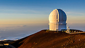 The last light of the day shines on an observatory on Mauna Kea, Island of Hawai'i.