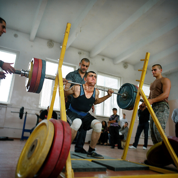 A young man representing the army participates to a three days competition of weight lifting in Stepanakert. The weight lifting federation has been created two years ago by Koren Khahramanian, three times champion of Armenia. 50 people are participating to this competition. The winner will become the champion of NAgorno Karabakh...Nagorno Karabakh, oct 2010, Shoushi..Magali Corouge/Documentography.