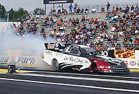 Jun 5, 2015; Englishtown, NJ, USA; NHRA funny car driver Tim Wilkerson during qualifying for the Summernationals at Old Bridge Township Raceway Park. Mandatory Credit: Mark J. Rebilas-