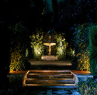 At night dramatic spotlights ensure that the fountain becomes the focal point of this garden