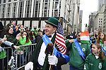 March 16, 2013 - New York, NY, U.S. - 'Leprechaun' NOEL RYAN, an alumnus of Quinnipiac College, greets those in crowd at the 252nd annual NYC St. Patrick's Day Parade. Thousands of marchers show their Irish pride, as they march up Fifth Avenue, and over a million people, often in green and orange, watch and celebrate. Those marching, many who wore kilts, uniforms, colorful costumes, sashes, included Bag and Pipe Bands; Irish dancers; fire, police, military, religious, educational, and social groups. The snow that begaan to fall in Manhattan after the parade started didn't stop the celebrations.