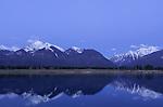 Soft purple light fills the atmosphere at dusk at the Kicking Horse Reservoir near St. Ignatius, Montana.