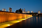 Bellevue skyline from downtown city park with fountain and waterfall at sunset with city lights
