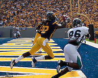 September 4, 2010: WVU defensive back Brandon Hogan (22) intercepts a pass. The West Virginia Mountaineers defeated the Coastal Carolina Chanticleers 31-0 on September 4, 2010 at Mountaineer Field, Morgantown, West Virginia.