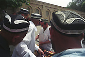 Men buy bread after friday prayers at the Juma Mosque, in Kokand, the Old Silk Road trading route city in the Ferghana valley. The Ferghana is becoming a hotbed of Islamic Fundamentalism. Uzbekistan.