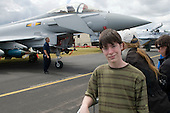 Young visitor infront of a Eurofighter Typhoon.    Farnborough International Airshow .