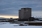 Old coal grading buildings, Ny Alesund, Svalbard. The coal mine, and the settlement were abandonded in 1963, after the Kings Bay Affair - 71 people were killed in accidents in the coal mines in between 1945 and 1963, and the Norwegian government resigned following an investigation. 21 people died in the 1962 accident. The mine closed down, and was later supplanted by the scientific research basis that exists today