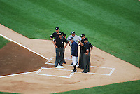 Umpire and Managers meet at Home Plate at Comerica Park in Detroit, MI