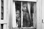 A mother and daughter look out a window in their Queen Anne's, Maryland home in 1981.