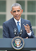 United States President Barack Obama answers a reporter's question as he conducts a joint press conference President XI Jinping of China  in the Rose Garden of the White House in Washington, DC on Friday, September 25, 2015.<br /> Credit: Ron Sachs / CNP