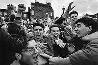 Falkirk FC fans celebrate an away goal during a football match in Edinburgh.