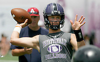 NWA Democrat-Gazette/DAVID GOTTSCHALK - Fayetteville High School's Taylor Powell passes during play against Midwest City High School Friday, July 10, 2015 during the Southwest Elite 7 on 7 tournament at Fayetteville High School.