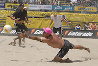 Huntington Beach, CA - 5/5/07:   Karch Kiraly dives for the ball during Kiraly / K. Wong's  21-17, 21-19 loss to Hyden / Keenan Saturday during the 2007 AVP CROCS Tour in Huntington Beach..Photo by Carlos Delgado