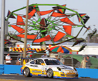 A car races past an amusement park ride during the Rolex 24 at Daytona , Daytona International Speedway, Daytona Beach, FL, January 2009.  )Photo by Brian Cleary)