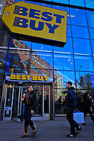 People walk next to one of Best Buy stores in Manhattan. Best Buy will Management discusses Q4 results on thursday in New York, United States. 28/03/2012.  Photo by Eduardo Munoz Alvarez / VIEWpress.